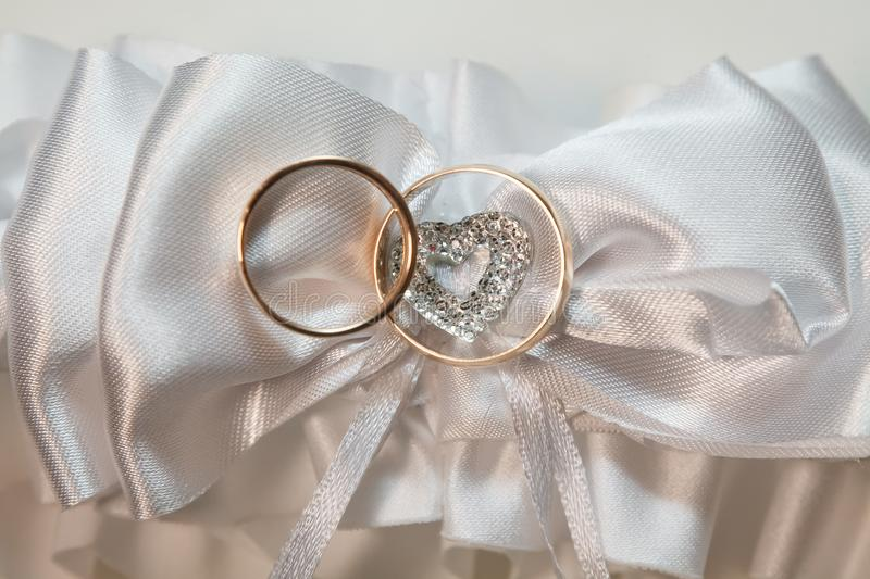 Wedding accessories with two golden rings royalty free stock image