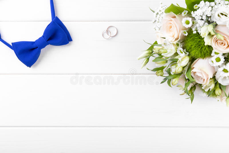 Wedding accessories on white wooden table. With copyspace stock photography