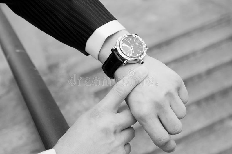 Groom with tuxedo and wristwatch stock photo