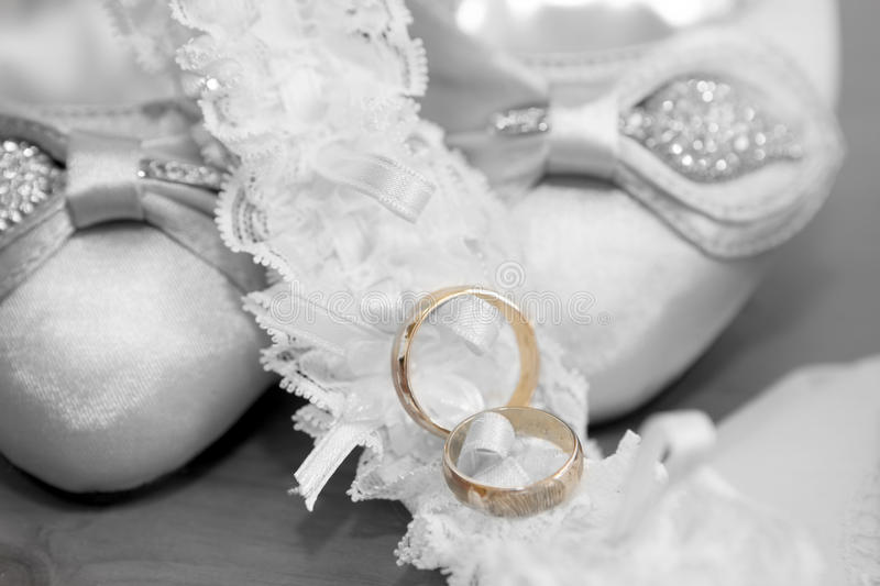 Wedding. Accompanied boyfriends alliance with shoes and garter belt royalty free stock image