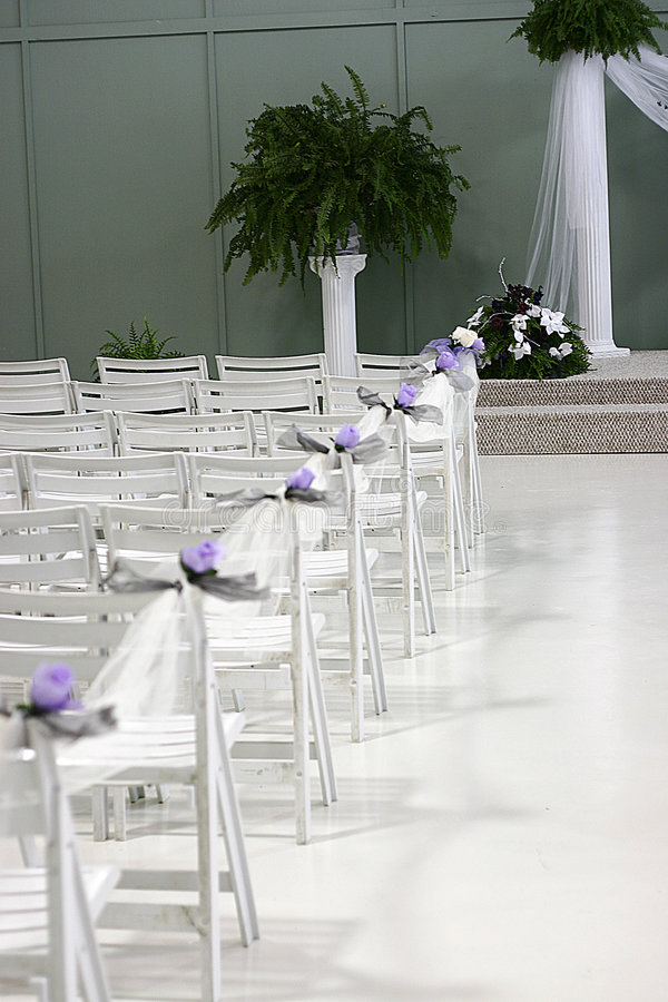 Wedding aisle of chairs stock image