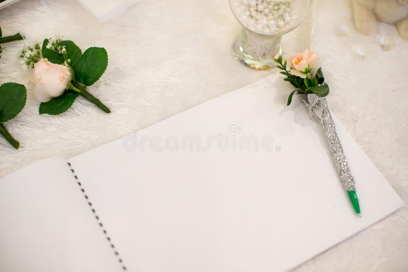 Wedding album, blank page, guest list, to do list.still life photography concept by memory and notebook. stock image