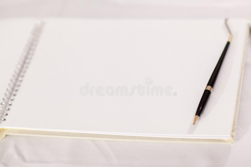 Wedding album, blank page, guest list, to do list.still life photography concept by memory and notebook. Notepad book.Notebook and asters on canvas background stock images