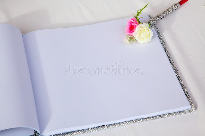 Wedding album, blank page, guest list, to do list.still life photography concept by memory and notebook. Notepad book.Notebook and asters on canvas background royalty free stock images