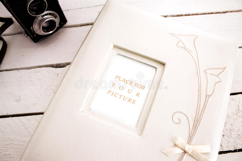 Wedding album with old camera royalty free stock photo
