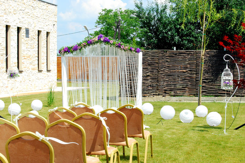 Wedding ambient. With white paper lanterns flowers, chairs royalty free stock images