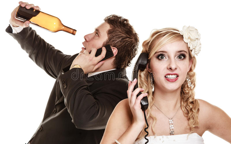 Wedding. Angry bride and groom talking on phone. Wedding relationship difficulties. Angry women and drunk men talking on the phone. Couple bride and groom royalty free stock photo