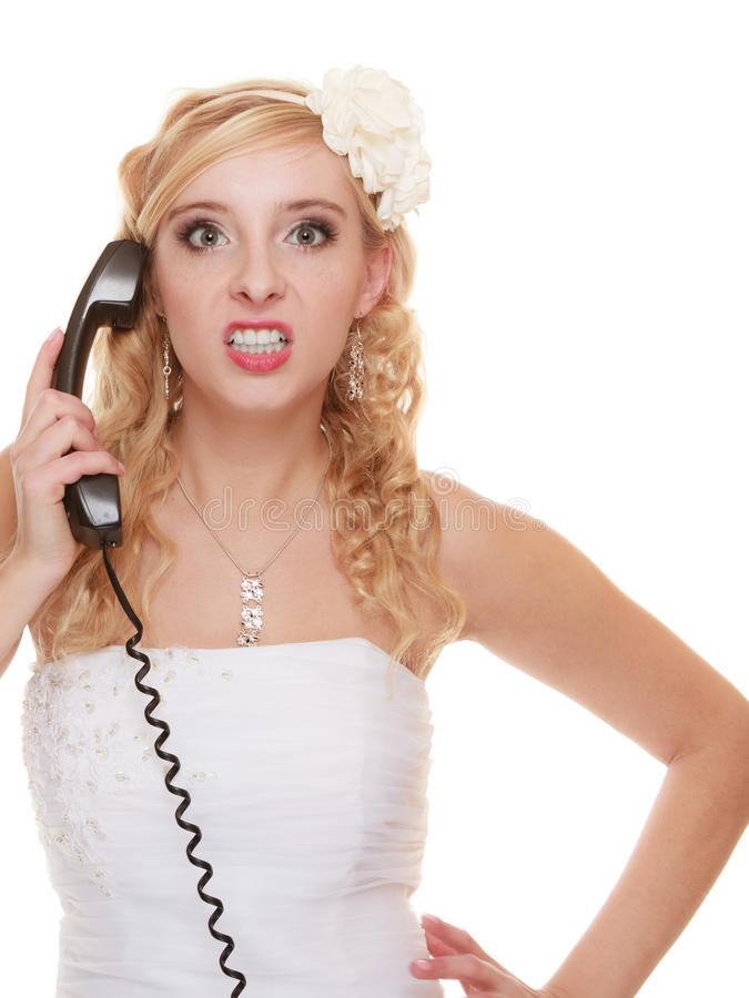 Wedding angry woman bride talking on phone. Wedding relationship difficulties. Angry woman talking on the phone. Fury bride screaming isolated on white stock photos
