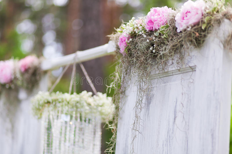 Wedding arch. Beautiful arrangement of flowers decorating a wedding ceremony arch closeup royalty free stock images