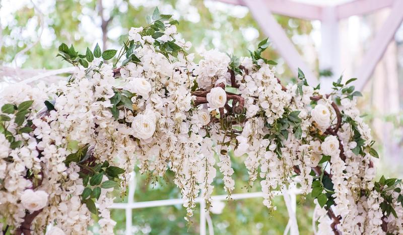 Wedding arch decorated with flowers. Beautiful wedding decor stock photo