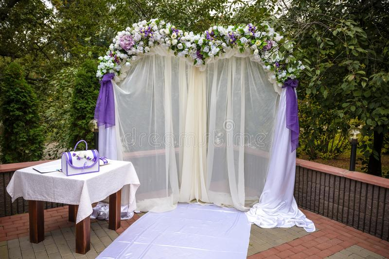 Wedding Arch Decorated With Flowers, White Chairs And Flowers ...