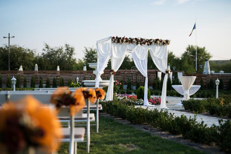Wedding arch decoration for engagement ceremony in sunny day.  royalty free stock images