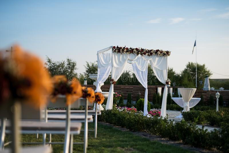 Wedding arch decoration for engagement ceremony in sunny day.  royalty free stock image