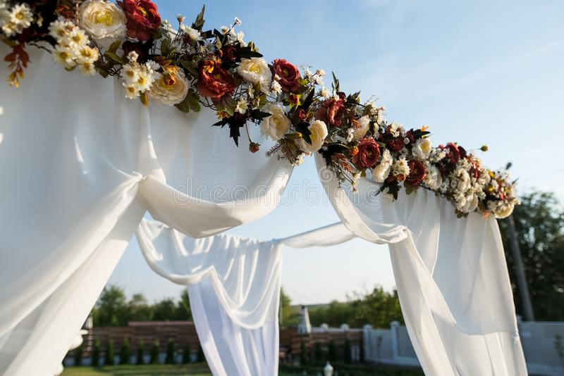 Wedding arch decoration for engagement ceremony in sunny day.  stock image
