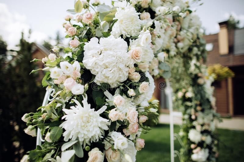 Wedding arch decoration with fresh flowers. Wedding arch decoration with white fresh flowers stock photography