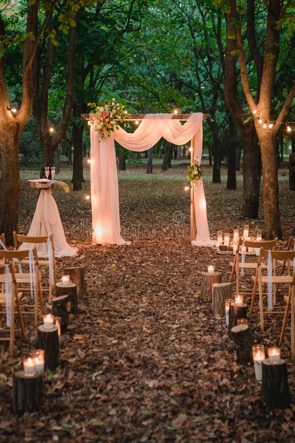 Wedding arch in the forest with light bulbs. rustic decor royalty free stock photos