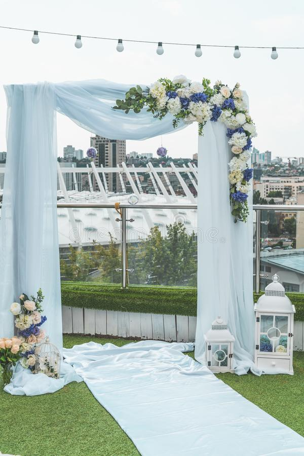 Wedding arch on the roof in the downtown of the megapolis under the open sky in summer, Kiev, Ukraine royalty free stock photos
