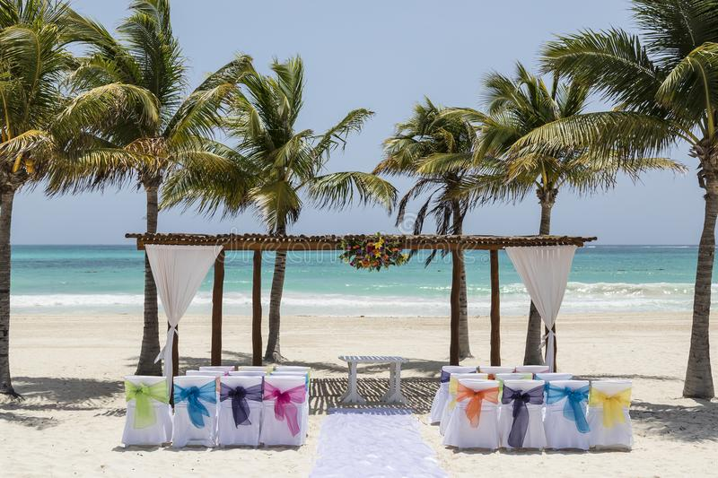Wedding arch and set up on tropical beach paradise - wedding and honeymoon concept. Wedding arch and set up tropical beach paradise honeymmon condept decoration royalty free stock photography