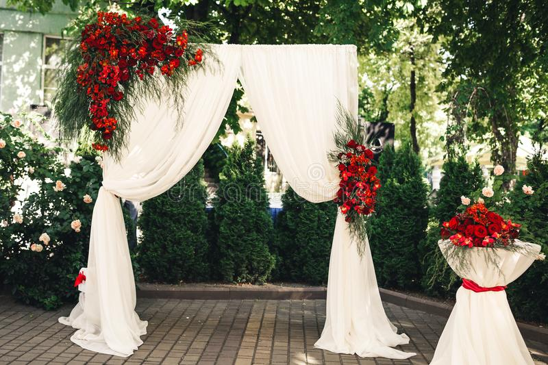 Wedding arch and table decorated with flowers stock image image wedding arch and table decorated with flowers wedding decorations junglespirit Choice Image