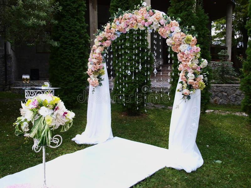 Wedding arch. And a table with wineglass in the meadow royalty free stock photos