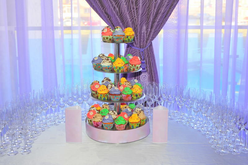Wedding Arrangement With A Colorful Cupcakes Stand Stock Image