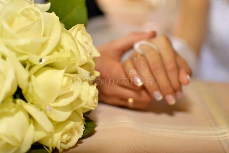 Wedding background, hands newlyweds stock photos