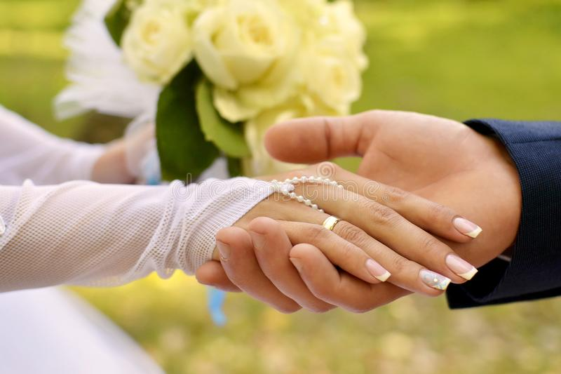 Wedding background, hands newlyweds stock photography
