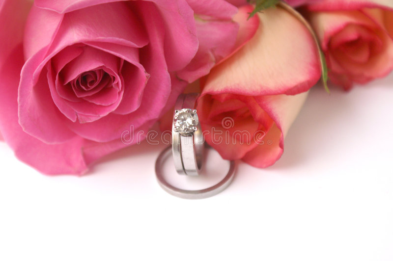 Wedding Bands And Roses Stock Photos