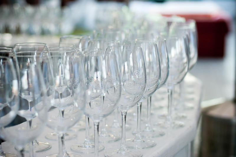 The Wedding Banquet. Banquet in the restaurant. Glasses of champagne in several rows on a mirror tray. On the table with a white tablecloth stock photo