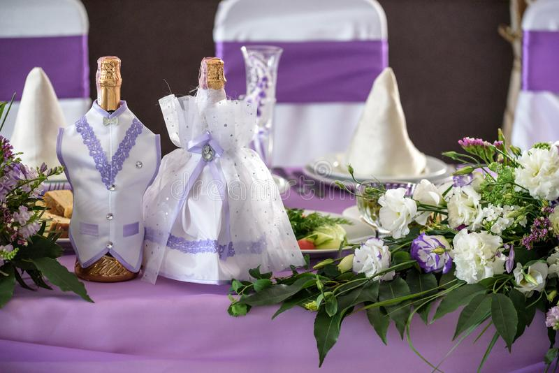 Wedding. Banquet. The chairs and round table for guests, served with cutlery, flowers and crockery and covered with a tablecloth royalty free stock photography