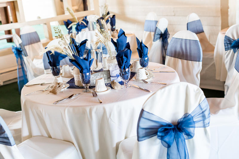 Wedding. Banquet hall decorated for wedding in white and blue royalty free stock image