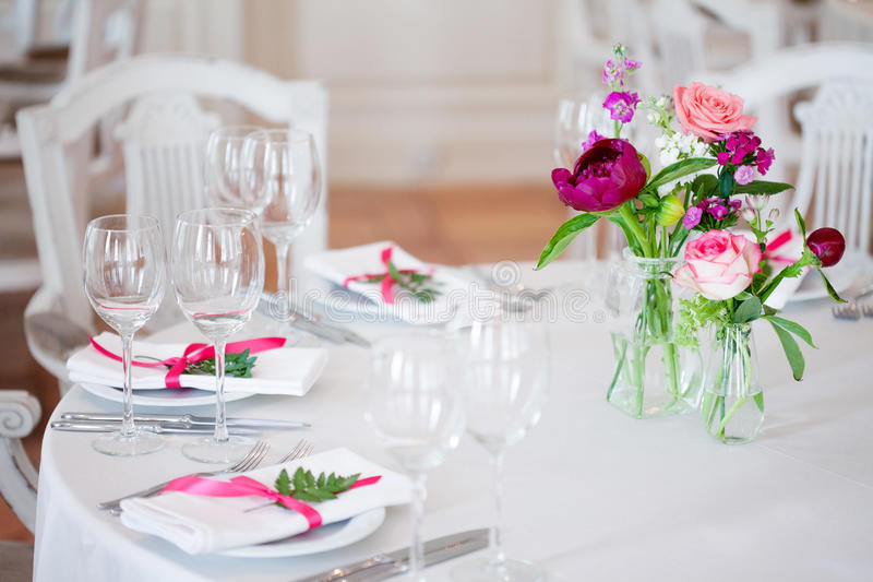 Wedding banquet, small restaurant floral, decor in red, informal style. stock photo