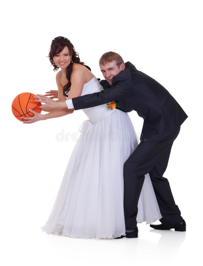 Wedding battle. Bride and groom are fighting for the ball royalty free stock image