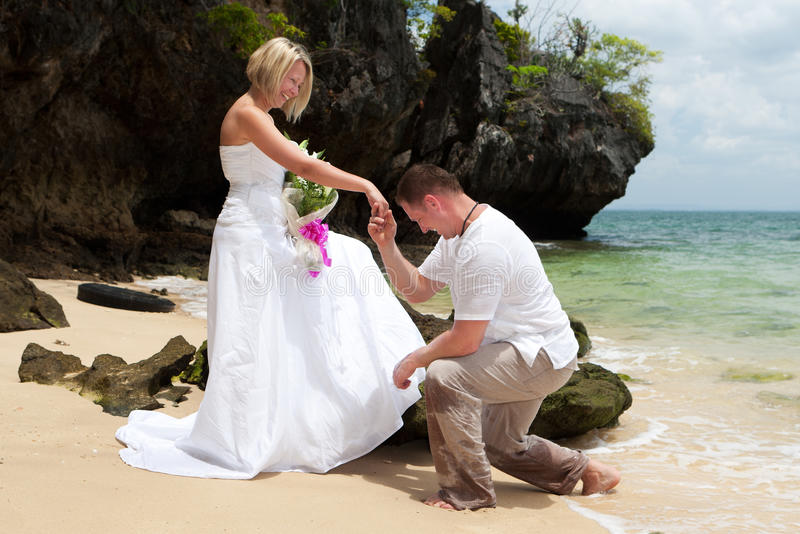 Wedding on the beach. Romantic honeymoon with happy people royalty free stock image