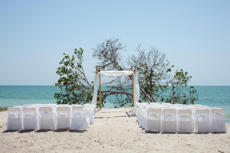 Wedding on the beach, chairs and chuppa