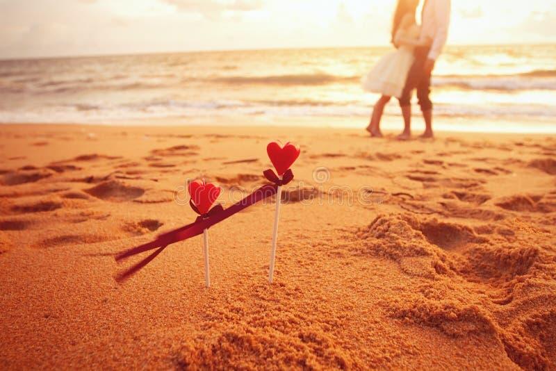 Wedding on the beach. Honeymoon on the beach, loving couple after wedding royalty free stock image