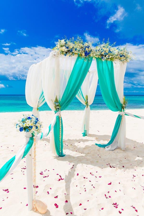 Wedding on the beach wedding arch decorated with flowers on tr download wedding on the beach wedding arch decorated with flowers on tr stock image junglespirit Gallery