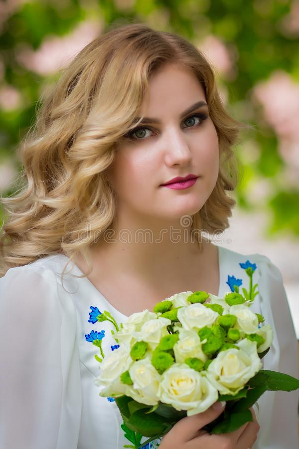 Wedding, beautiful girl with a wedding bouquet stock photography