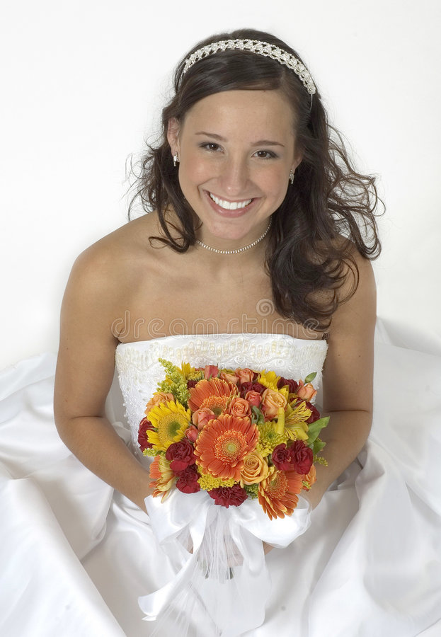 Wedding Bells. Beautiful brunette bride smiles for the camera, her wedding is only a week away. Happy Bride stock images