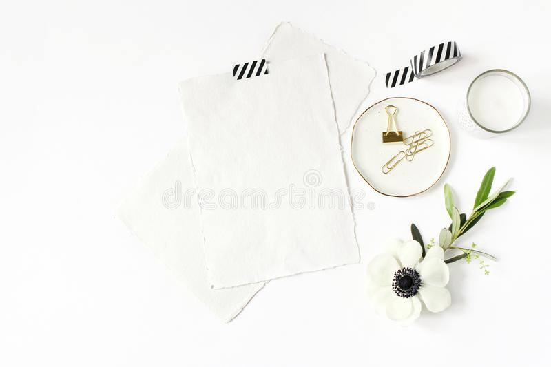 Wedding, birthday desktop mock-up scene. Blank cotton paper greeting cards, washi tape and golden clips. Olive branch stock photo