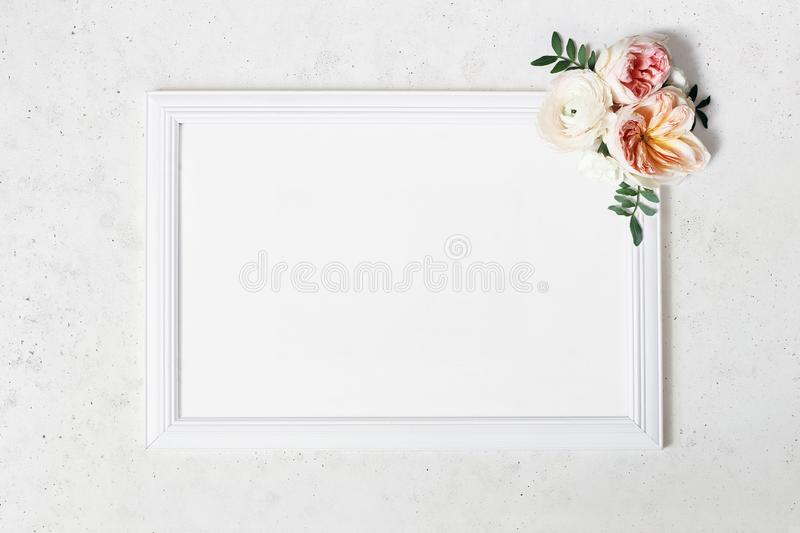 Wedding, birthday sign board mock-up scene. Blank white wooden frame. Decorative floral corner. Green leaves, pink stock photo