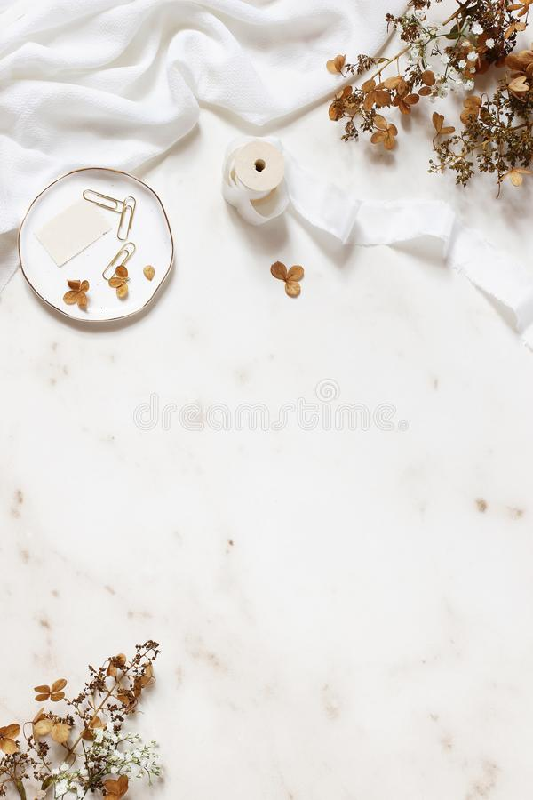 Wedding, birthday stationery styled stock photo. White table runner, porcelain plate with stamp, golden clips, silk stock photos