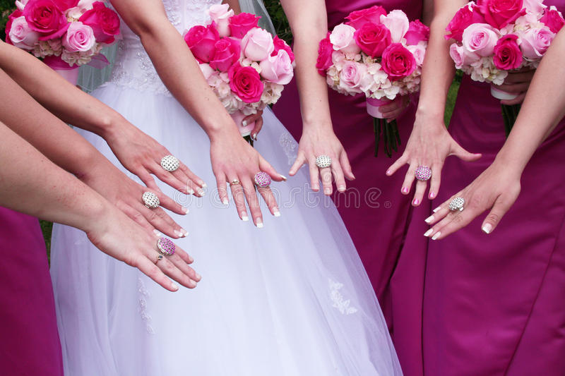 Wedding Bling. Bride and fashionable attendants show off their matching wedding day 'bling royalty free stock photos