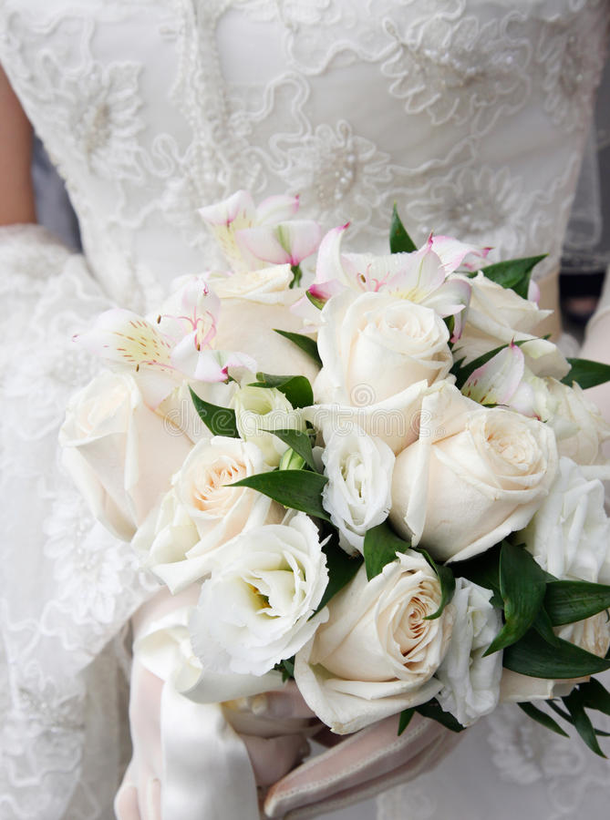 The wedding bouquet. The bride with a wedding bouquet royalty free stock image
