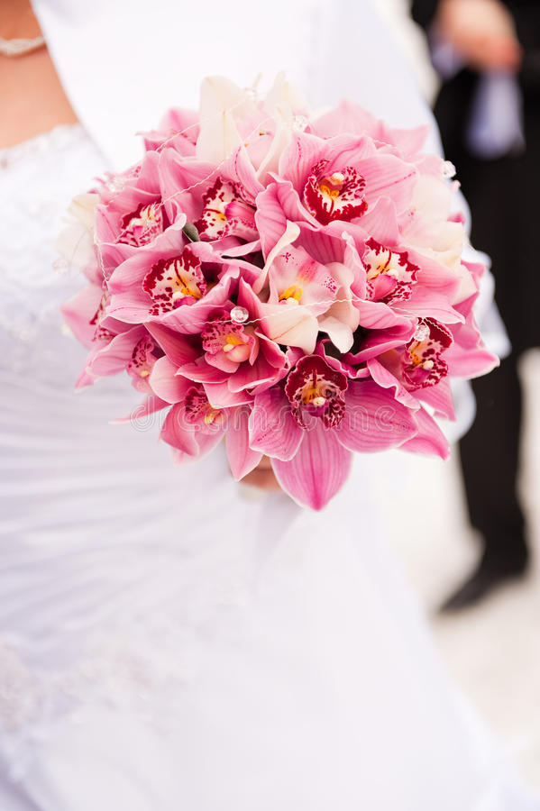 Wedding bouquet. Bride, groom and bouquet... - shallow depth of field stock photo