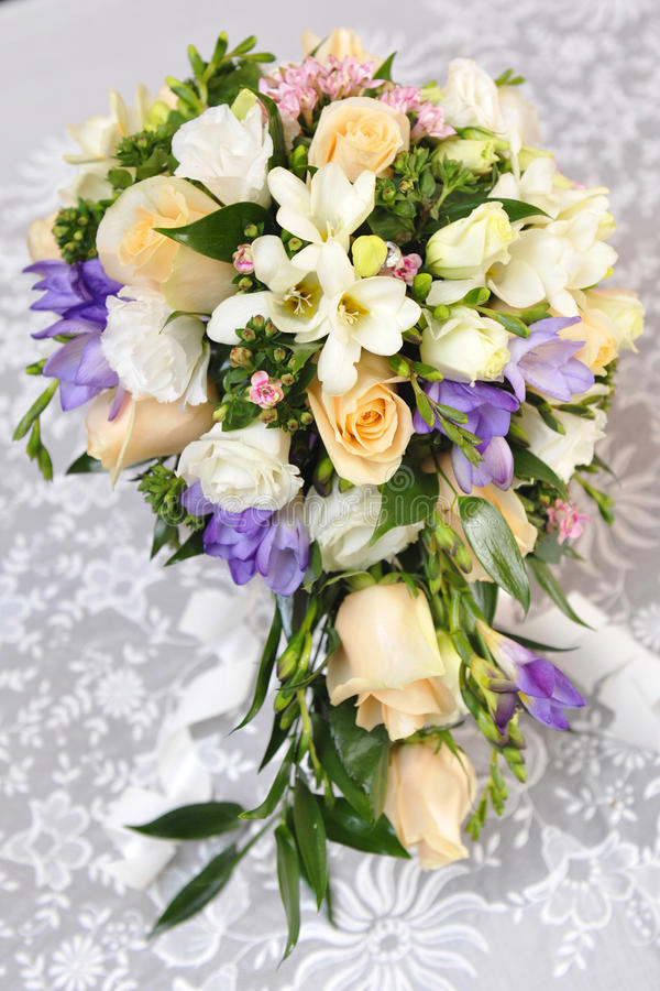 A WEDDING BOUQUET. Beautiful wedding flowerses on a table stock photo