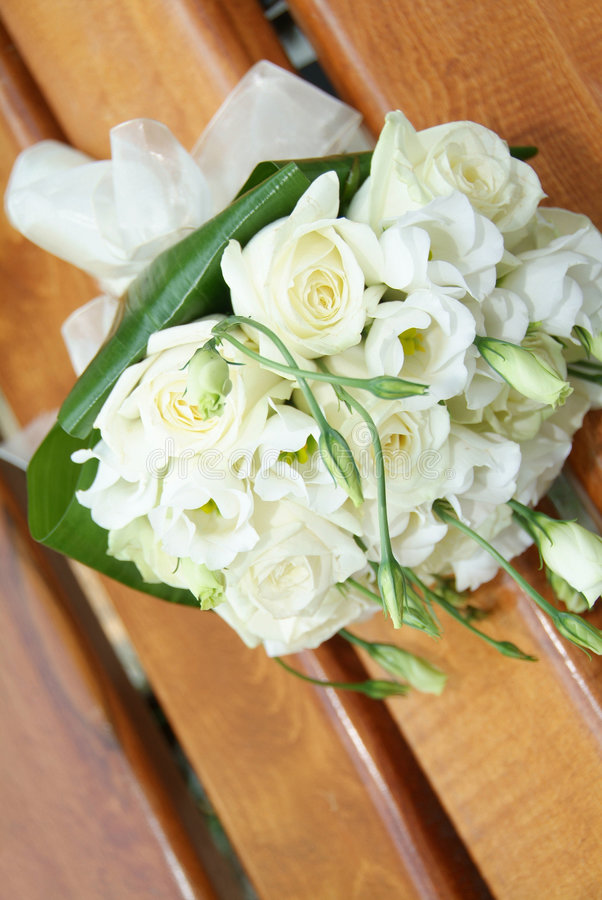 Wedding bouquet. White roses in a wedding bouquet royalty free stock images