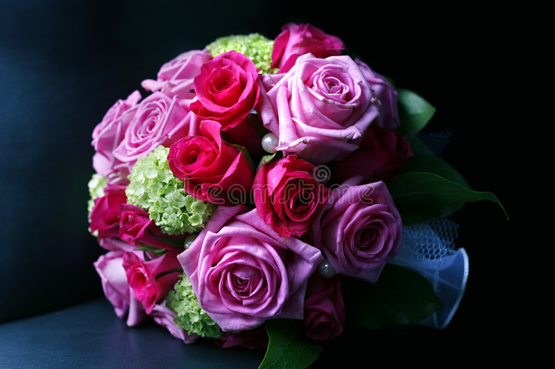 Wedding bouquet. From roses on a dark background royalty free stock photo