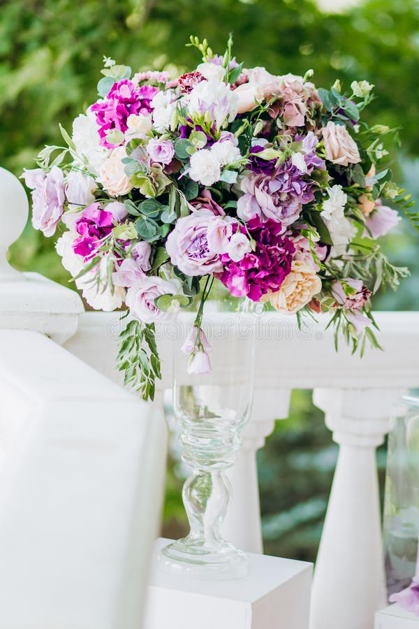 Wedding bouquet. Wedding bouquet on the background of the bride and groom stock photo