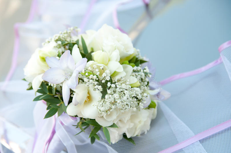 Wedding Bouquet On Banch. White Flowers On Blue Background Stock Photo